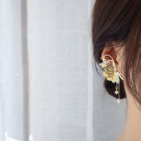 Earrings new wave Korean fashion temperament wild three-dimensional pearl butterfly cold wind personality earrings wholesale nihaojewelry NHNT221244's discount tags