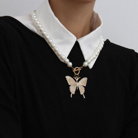fashion jewelry personalized retro large butterfly micro-inlaid necklace business imitation pearl single layer buckle necklace wholesale nihaojewelry NHXR221307's discount tags