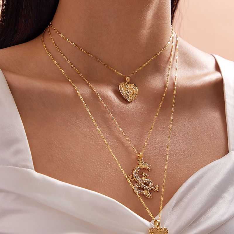 fashion jewelry retro heart-shaped rose pendant necklace personalized cold wind micro-set dragon necklace wholesale nihaojewelry NHXR221312
