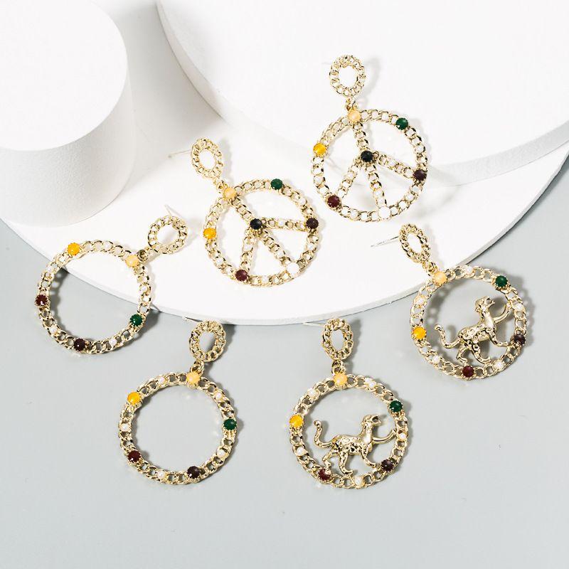 fashion retro round pearl earrings alloy diamond-set leopard earrings long exaggerated earrings wholesale nihaojewelry NHLN224267