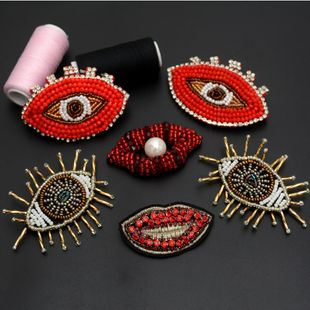 Handmade beaded crystal eyes Jie Mao lips cloth stickers clothing accessories DIY clothes bag decoration NHNK224348's discount tags