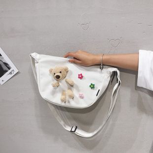 cute bear doll canvas messenger bag Korean flower girl student shoulder bag wholesale nihaojewelry NHHX225040's discount tags