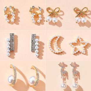 Korean style asymmetry stars elk bow pearl earrings simple spread wholesale nihaojewelry NHGY225418's discount tags