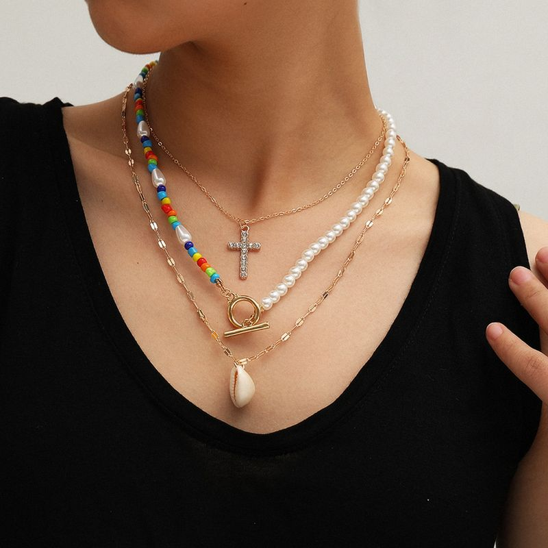 fashion jewelry wild ocean wind shell necklace fashion asymmetric handmade beaded cross necklace wholesale nihaojewelry NHXR225447
