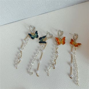 Mori dulce pendientes de mariposa feminidad borla pendientes de verano cristal de perlas pendientes franceses aguja de plata al por mayor nihaojewelry NHYQ225633's discount tags
