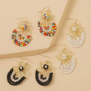 Korean cute hand-woven flowers rice beads resin earrings jewelry wholesale nihaojewelry NHLA225692's discount tags