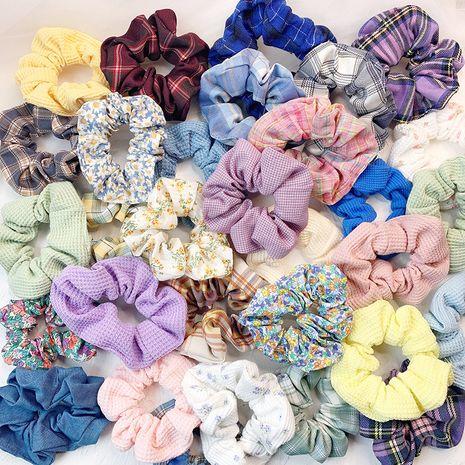 Korean girl floral lattice hair circle French retro hair rope wholesale nihaojewelry NHOF225743's discount tags