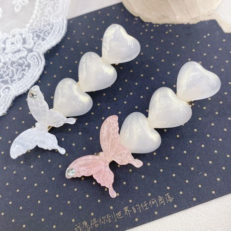 South Korea butterfly pearl rhinestone side clip simple fashion love cute hairpin wholesale nihaojewelry NHSM226277's discount tags