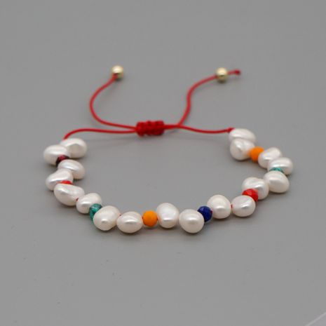 Niche Creative Rope Color Rice Bead Bracelet Baroque Natural Pearl Handmade Jewelry wholesale nihaojewelry NHGW226710's discount tags