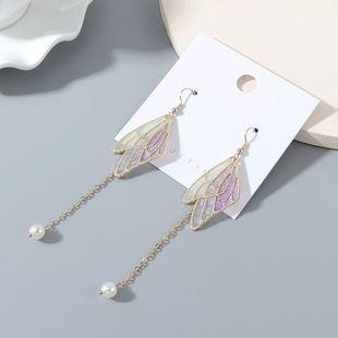temperamento chapado en oro retro personalidad de la moda salvaje borla mariposa ala perla pendientes al por mayor nihaojewelry NHPS227062's discount tags