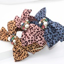 New fashion leopard cloth bowknot headband diamond pearl personalized ladies street shot hair accessories wholesale nihaojewelry NHWJ221519