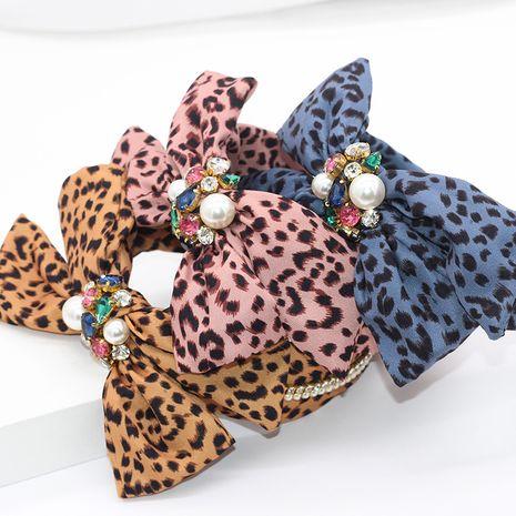 New fashion leopard cloth bowknot headband diamond pearl personalized ladies street shot hair accessories wholesale nihaojewelry NHWJ221519's discount tags