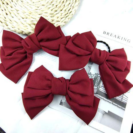 Korean fashion three-layer big bow hairpin high-end fabric spring clip edge clip high-end super fairy top clip girl  wholesale nihaojewelry NHUX221674's discount tags