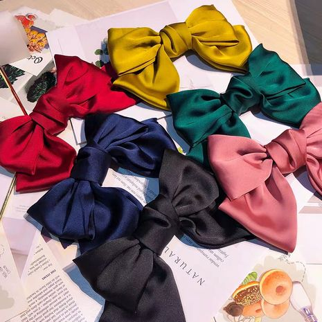 South Korea's new wide-end high-end satin bow hairpin fashion Korean clip wild side clip card children  wholesale nihaojewelry NHUX221689's discount tags