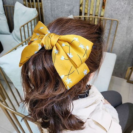 Mode coréenne le nouveau petit noeud floral en épingle à cheveux tissu haut de gamme simple et petit en épingle à cheveux fraîche à large face super fée clip en gros NHUX221699's discount tags