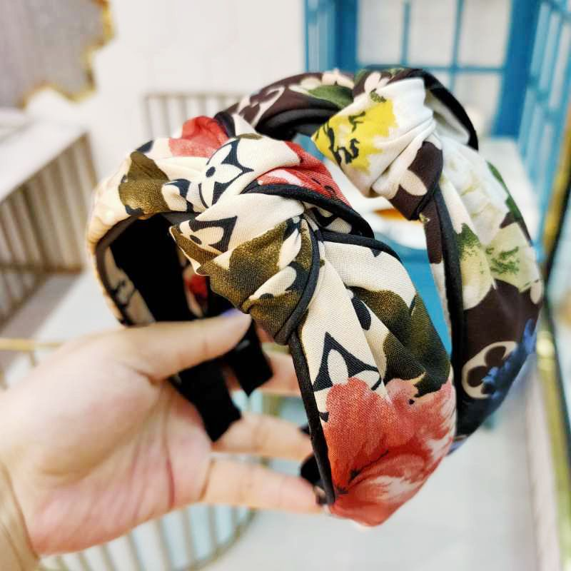 Korean wide-brimmed high-end fabric knotted headband retro simple printing head jewelry temperament pressure headband girl wholesale nihaojewelryd NHUX221709
