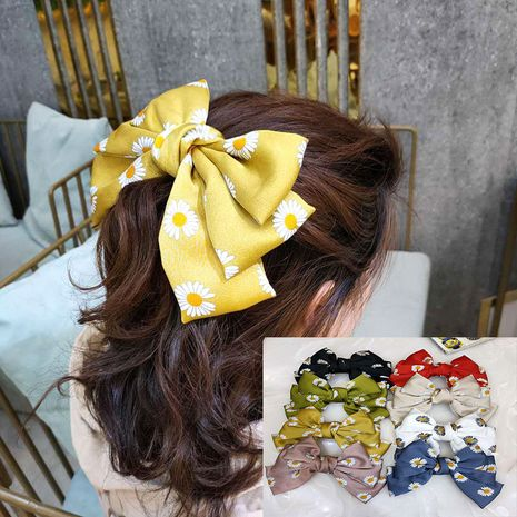 Korean fashion section small daisy hair clip high-end fabric simple hairpin super fairy bowknot clip hair accessories wholesale nihaojewelry NHUX221756's discount tags