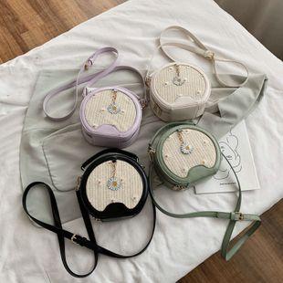 nouveau coréen texture petite marguerite tissé épaule sac de messager femme mode occidentale portable petit sac rond en gros NHPB227311's discount tags