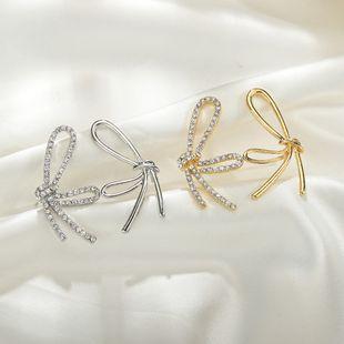 S925 silver bowknot rhinestone earrings creative metal asymmetrical trendy earrings wholesale nihaojewelry NHBQ227572's discount tags