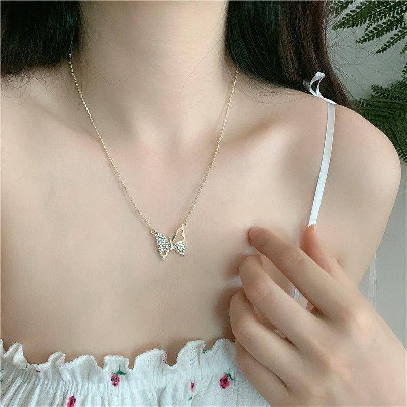 South Koreas new jewelry Mori womens flash diamond butterfly necklace tide neck chain clavicle chain wholesale nihaojewelry NHYQ227602