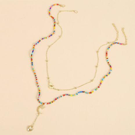 Longue Bohème Étoile Deux Riz Perle Colliers Tendance Main Tissé Amour Pendentif en gros nihaojewelry NHLA227635's discount tags