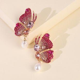 new big rhinestone butterfly wings pearl earrings exaggerated big ladies earrings wholesale nihaojewelry NHJJ227660's discount tags