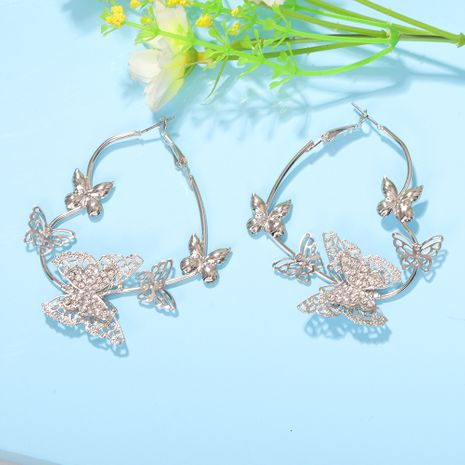 mode rétro en forme de papillon boucles d'oreilles en trois dimensions creux diamant boucles d'oreilles en maille en gros nihaojewelry NHJQ227702's discount tags