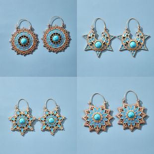 Retro Sun Flower Geometric Flowers Turquoise Blue Ethnic Style Earrings Fashion Carved Hollow Earrings wholesale nihaojewelry NHGY227762's discount tags
