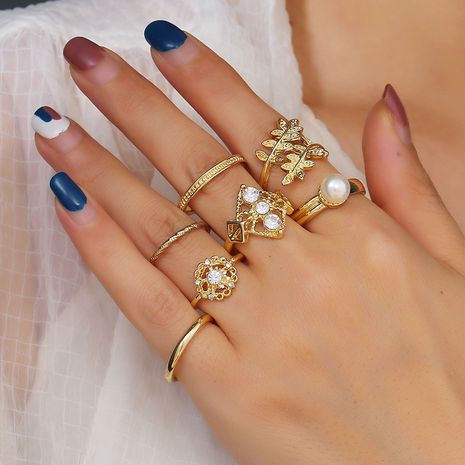 Simple fashion creative set ring new diamond leaf pearl 7 piece set ring wholesale nihaojewelry NHKQ227882's discount tags