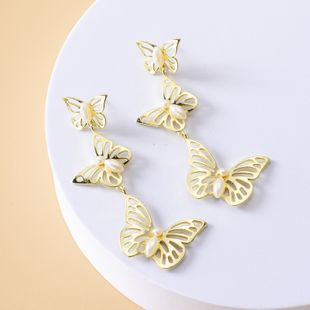 hot selling explosion models fashion pearl butterfly earrings wholesale nihaojewelry NHOT227999's discount tags