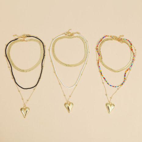 Bohème créative perles de riz à la main trois multicouches collier amour perle pendentif bijoux en gros nihaojewelry NHLA228309's discount tags