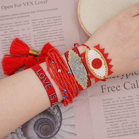 Pulsera de múltiples capas borla cinta Miyuki granos de arroz tejido ojo de la suerte joyería hecha a mano al por mayor nihaojewelry NHGW228692's discount tags