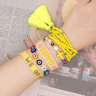 Pulsera de perlas naturales de moda Miyuki cuentas de arroz de cristal tejido alfabeto borla joyería hecha a mano al por mayor nihaojewelry NHGW228703's discount tags