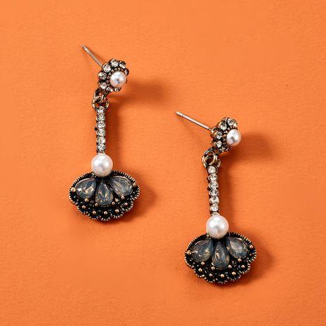 Fashionable alloy acrylic diamond-set flower style pearl earrings Korean earrings wholesale nihaojewelry NHGY229328's discount tags