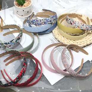 retro lattice floral headband Korea explosion style hair hole simple headband wholesale nihaojewelry NHRH229601's discount tags