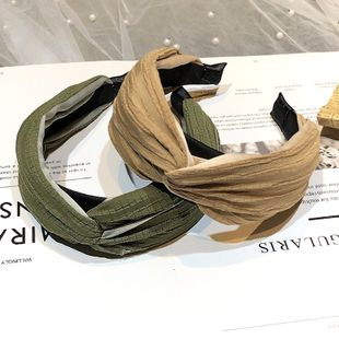 Korean fashion fabric hair stitching fold headband cross-knotted wide-brimmed wholesale nihaojewelry NHRH229602's discount tags