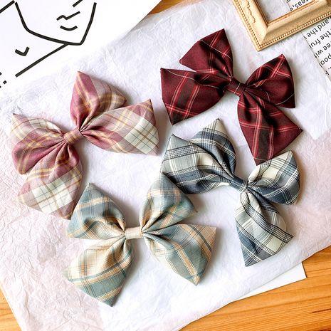 Gros arc clip coiffe satin treillis en épingle à cheveux coréen fille cheveux accessoire en gros nihaojewelry NHSA229644's discount tags