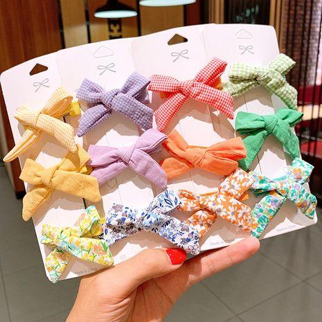 Accessoires de cheveux coréens petit tissu floral arc en épingle à cheveux fille style enfants treillis en épingle à cheveux pression clip côté clip NHSA229646's discount tags