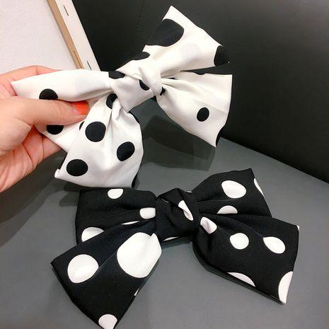 new fabric Korean black and white polka dot bow steel clip bomb yellow clip headdress wholesale nihaojewelry NHHI229649's discount tags