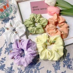 Korean large hair scrunchies hair ring girl head rope chrysanthemum cloth hair rope large hair band wholesale nihaojewelry NHOF229656's discount tags