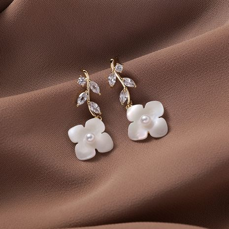 Korean 925 silver needle white flowers holiday style petal flower exaggerated earrings wholesale nihaojewelry NHMS229810's discount tags