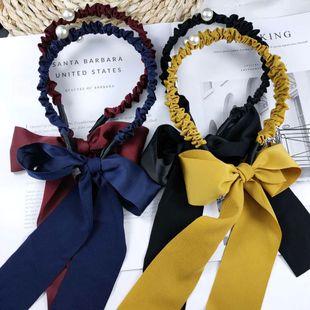 Korean super fairy streamer knotted headband sweet bow pearl hairpin new headband wholesale nihaojewelry NHUX229933's discount tags