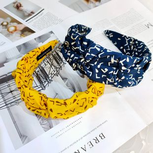 Korean simple wide-brimmed letter fold headband high-end retro fabric floral headband fashion wholesale nihaojewelry NHUX229939's discount tags