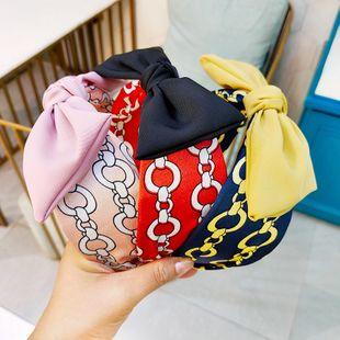 Korean wide-brimmed chain printing bow tie hair hoop retro high-end rabbit ear hair card fabric headband wholesale nihaojewelry NHUX229942's discount tags