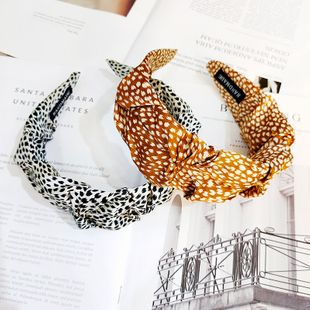 Korean retro leopard pattern wide-brimmed fold headband simple high-end fashion bud hairpin wholesale nihaojewelry NHUX229943's discount tags