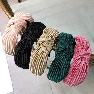 Korean new candy-colored pleated knotted headband solid color fabric headband wave hair accessories ladies wholesale nihaojewelry NHUX229952's discount tags
