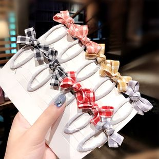 Korean children's bow hairpin sweet girl side clip girl baby side clip hair accessories wholesale nihaojewelry NHNA230057's discount tags