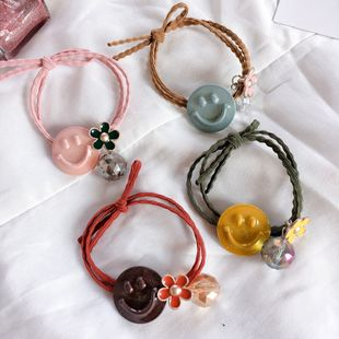 Korean pearlescent oily smile face small flowers simple knotted rubber band hair scrunchies headdress wholesale nihaojewelry NHHI230191's discount tags