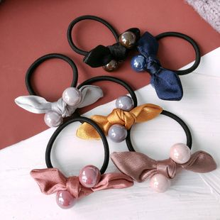 Korean forged surface fabric small ears bow color pearl ball parent-child hair band rubber band hair accessories wholesale nihaojewelry NHHI230193's discount tags
