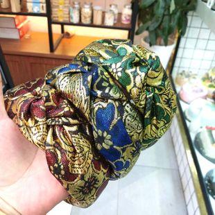 Estilo de moda de ala ancha anudada simple diadema de color impreso accesorios de seda de seda de oro al por mayor nihaojewelry NHUX222342's discount tags